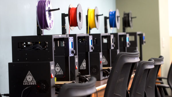 A row of Lulzbot Mini2 3D printers is pictured in the new Makerspace in King Library