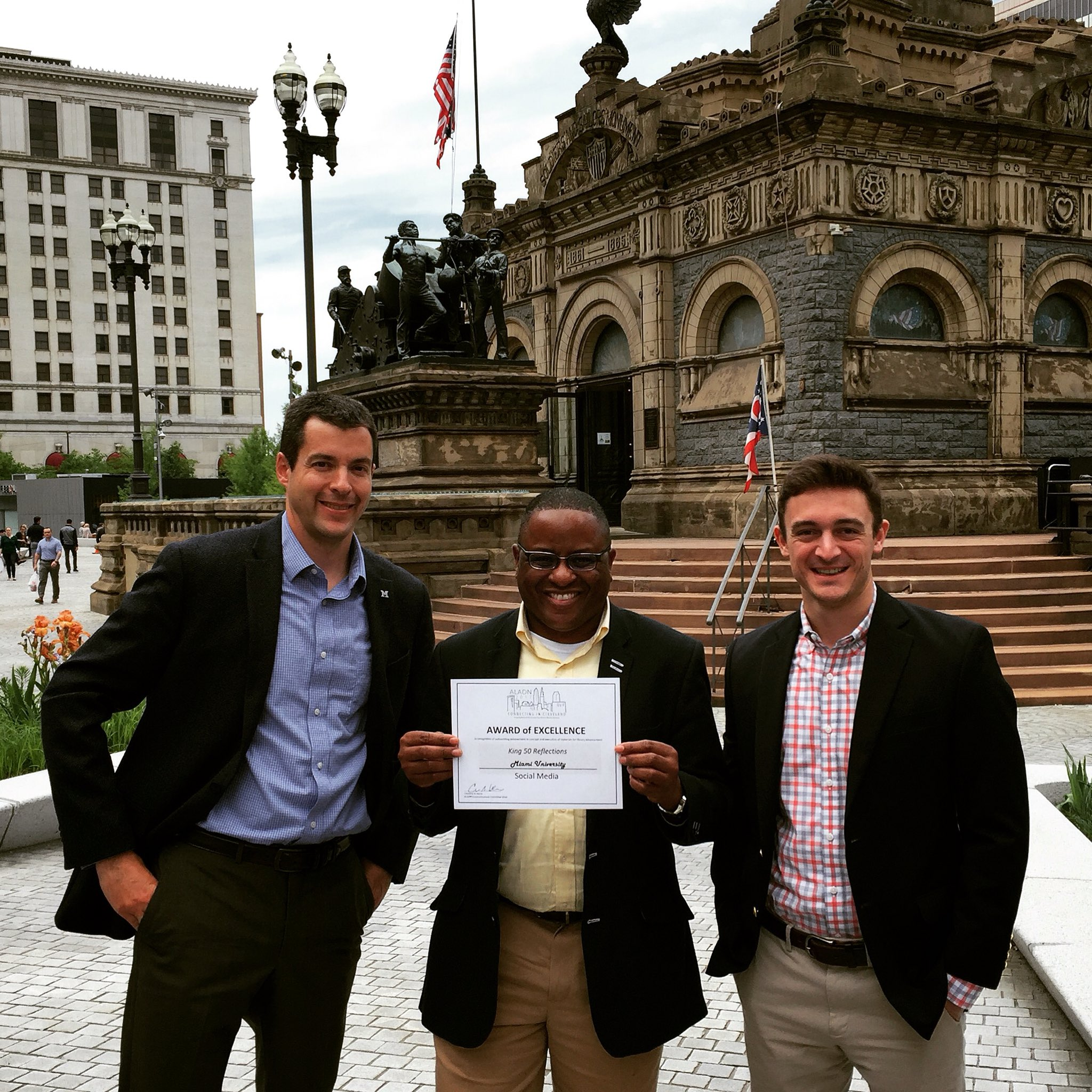 Vince Frieden, Jerome Conley, and David Mulford holding an Award of Excellence recognizing the 'King 50 Reflections'